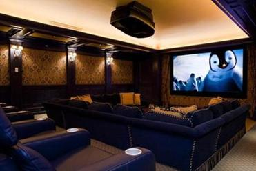 Roy MacDowell's Wayland home includes a home theater. The town of Wayland values the property at about $8 million, and it is slated to be auctioned on Friday.