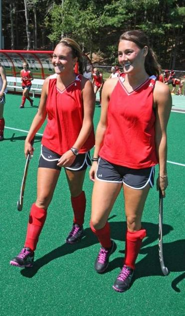 Alyssa (left) and Katie Carlson of Watertown are teammates again this fall, playing field hockey for Northeastern University; Katie is a junior, while Alyssa is a freshman.