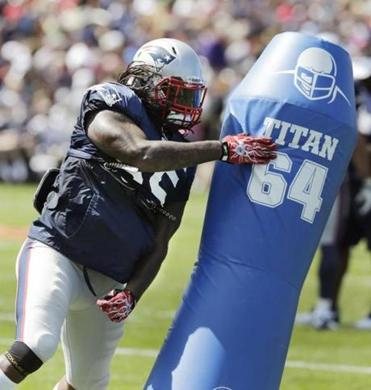 Linebacker Brandon Spikes was back to work Wednesday after missing Tuesday's practice. (AP/Charles Krupa)