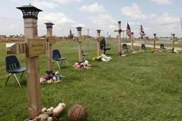 Crosses were placed in tribute to students killed at Plaza Towers Elementary in a tornado on May 20 in Moore, Okla.