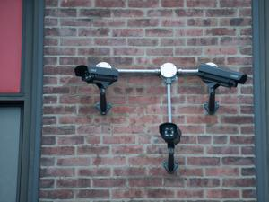 Some schools in the region have recently installed security cameras, like these, set up this summer at a Quincy elementary school.