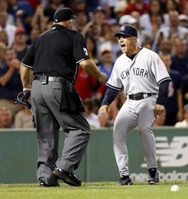 Yankees manger Joe Girardi (right) argued with umpire Brian O'Nora.