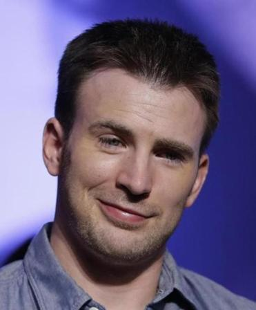 Actor Chris Evans listened to a reporter's question during a July 29 news conference in Seoul, South Korea.