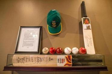 A cricket bat signed by the Indian team on display at Hit Wicket in Cambridge.