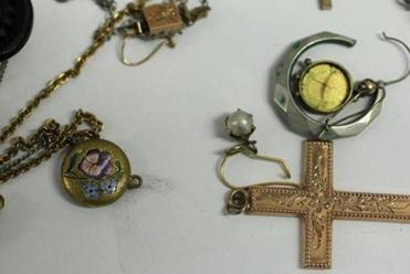 "The safe contained what MacDonald called ""costume jewelry,"" including a bronze cross necklace and a Masonic ring. The jewelry will be turned over to the state's unclaimed property division, which will auction it off on eBay."