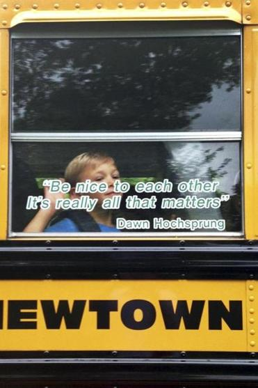 A kindergarten student from Sandy Hook Elementary School in Connecticut waved from a school bus on Tuesday.