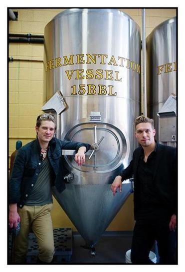 Taylor and Isaac Hanson at the brewery. Hanson's beer is called Mmmhops.