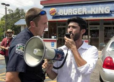 A police officer ordered Greg Casar, who was addressing  a  crowd of about 200 in Austin, Texas, off Burger King property.