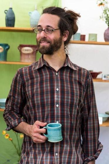 Lifelong potter Jeremy Ogusky makes fermentation crocks, useful for pickling cukes. He made his mug too.
