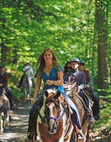 Open Acre Ranch guides riders up into the hills and through its 400-acre spread of woods and meadow.