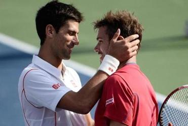 Top-seeded Novak Djokovic (left) consoles Stanislas Wawrinka after Djokovic won their five-set US Open semifinal.