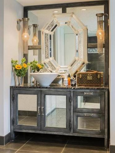 The custom vanity is made of industrial-grade steel, while an inset mirror, a family heirloom, adds a touch of the feminine.