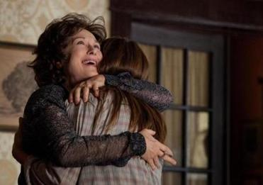 "Meryl Streep hugs Julia Roberts in a scene from ""August: Osage County."""