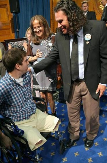 Jeff Bauman (left) — the 27-year-old who lost both legs in the attack — and Carlos Arredondo (right) — the 53-year-old who wheeled him to safety — will be there for the speech.