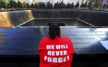 A woman paused to read names on the 9/11 Memorial in New York at a ceremony Wednesday. In Washington, President Obama observed a moment of silence on the South Lawn of the White House.  And in Shanksville, Pa., a Navy quartermaster took part in a wreath-laying ceremony honoring victims on Flight 93.