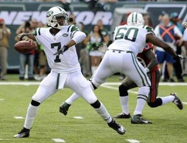 Geno Smith in action against the Buccaneers last Sunday, his NFL debut. (AP Photo/Bill Kostroun, File)