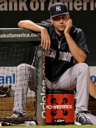 Derek Jeter watched from the dugout during Wednesday's game.