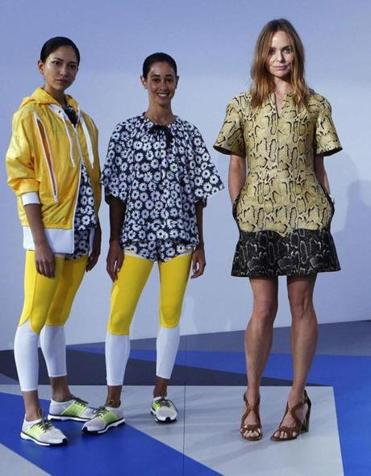 Stella McCartney (right) at London Fashion Week with models wearing workout clothes she designed for Adidas.
