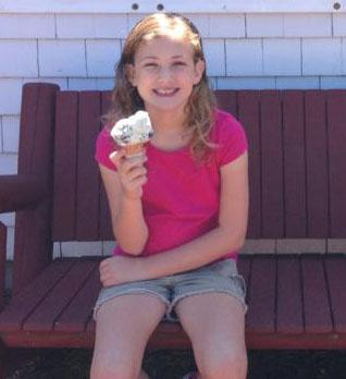 Libby Stott, 9, of Holliston enjoying a cone at Smitty's. She rated ice cream parlors on Cape Cod over the summer
