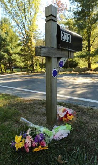 Mourners left flowers in front of Shayne Desroches' home in Hopkinton on Thursday.