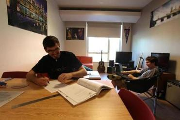 Alex Montemurro and Connor Williams  study in their suite.