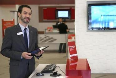 Dave Baird-Miller, a Bank of America staffer in the Back Bay, carries a tablet computer so he can help customers.
