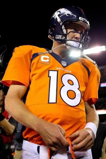 Broncos QB Peyton Manning went 32 of 37 for 374 yards against the Raiders.