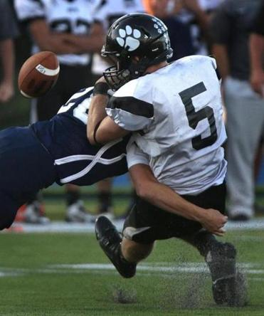 Plymouth South's Dylan Oxsen (5) was outstanding, though he was jarred by Jake Zaniboni in the fourth quarter.