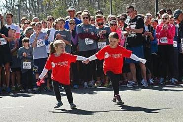 In April, a race for Caroline drew thousands, and she unexpectedly darted out to join the participants.