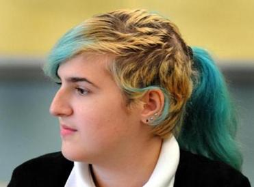 Notre Dame Academy student Olivia DiPietrantonio, 17, listened during a body image class.