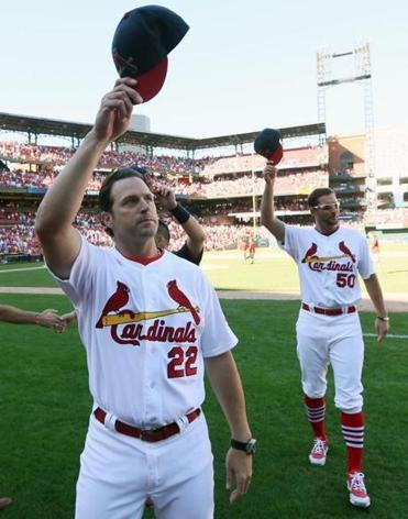 Cardinals manager Mike Matheny leads his team's salute of the fans at Busch Stadium.