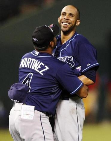 David Price, embraced by bench coach Dave Martinez, was sensational in pushing Tampa into the AL wild-card playoff game against Cleveland.