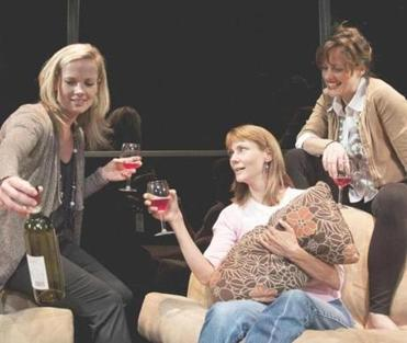 "Tamara Hickey, Cate Damon, and Abigail Killeen in New Repertory Theatre's production of ""Rancho Mirage."""