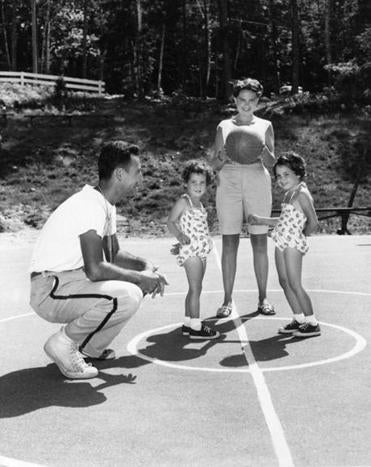 Missie and Bob Cousy, shown with daughters Ticia and Marie, were married for 63 years.