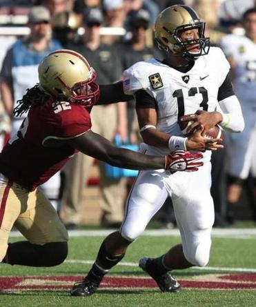 BC linebacker Steven Daniels pulls down Army quarter-back Kelvin White for one of his two sacks and 11 tackles.