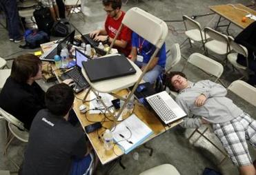 Ted Meyer (right), 19, who attends Worcester Polytechnic Institute, slept as his team worked on a hack that would allow an image to be parsed into html.