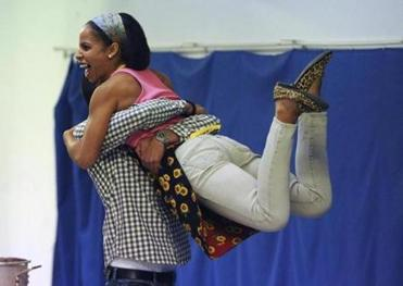 "Danny Mourino picks up costar Alexandria King during rehearsal for ""Splendor."""