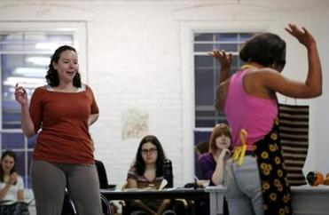 "Actors Becca A. Lewis (left) and Alexandria King rehearse for Company One's production of ""Splendor."""