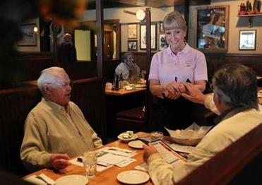 Susan Henderson, a Hilltop waitress for 35 years, served Tony Bruno of Revere (left) and Peter Mastrangelo of Everett.
