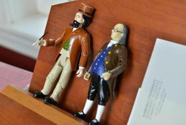She also has figurines of Charles Dickens and Benjamin Franklin.