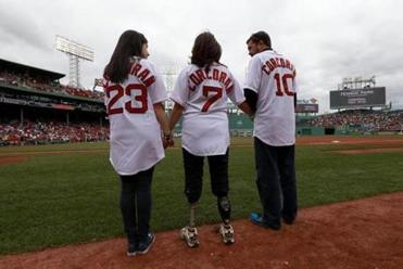 Before a game in September against the Yankees, Sydney, Celeste, and Kevin Corcoran prepared to deliver a first pitch. Sydney and Celeste Corcoran were badly injured.