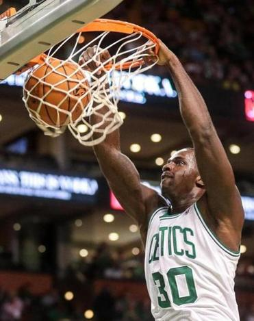 Brandon Bass dunked during the Celtics' victory over the Nets. Bass contributed 16 points and nine rebounds.