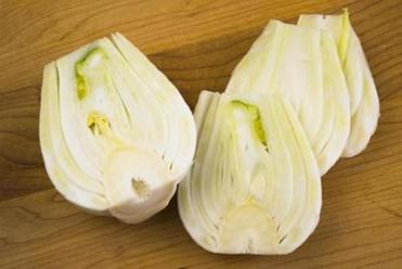 TIP Keeping the core in the fennel slices makes them easier to turn in the pan. Once cooked, cut out the core.