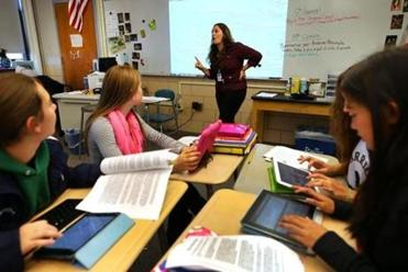 Students in teacher Cynthia McClellan's 8th grade social science and history class at the Blake Middle School use their iPads during class.