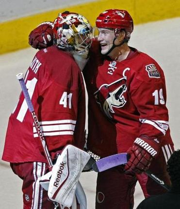 Shane Doan. right, congratulated goalie Mike Smith on his goal.