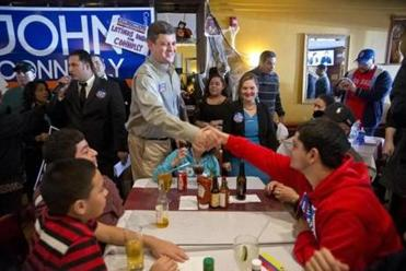 John Connolly shook hands with David Gonzalez, 18, of East Boston, during a campaign stop at La Hacienda Restaurant in East Boston.