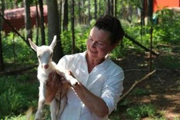 Gail Hobbs-Page with a newborn goat at Caromont Farm in Esmont, Va.