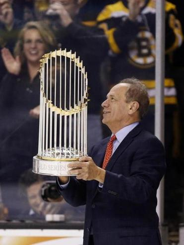 Red Sox CEO Larry Lucchino brought the World Series trophy to the Bruins game on Thursday.
