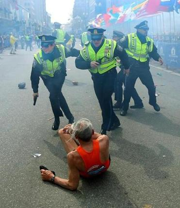 Globe photographer John Tlumacki won best of show for his iconic photograph of 78-year-old marathon runner Bill Iffrig.
