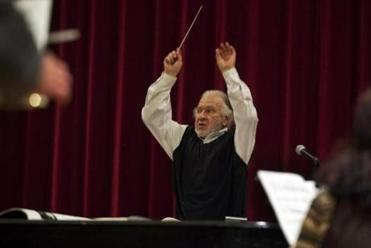 "Douglas Weeks, one of three conductors, leads orchestra 2 in a rehearsal of ""Gruppen."""